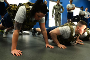 """Demonstration of the two phases of a correct Air Force push-up, from the """"Top Dog"""" competition at Minot Air Force Base."""